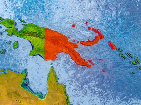 Papua New Guinea in red on realistic map with embossed countries. 3D illustration.
