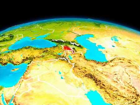 Satellite view of Armenia highlighted in red on planet Earth with borderlines. 3D illustration. Stock Photo