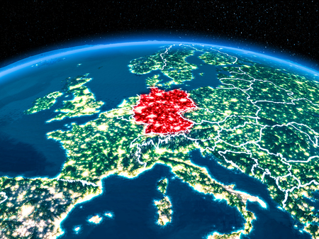 Orbit view of Germany highlighted in red with visible borderlines and city lights on planet Earth at night. 3D illustration. Stock Photo
