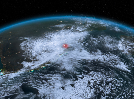 Satellite night view of Swaziland highlighted in red on planet Earth with clouds. 3D illustration.