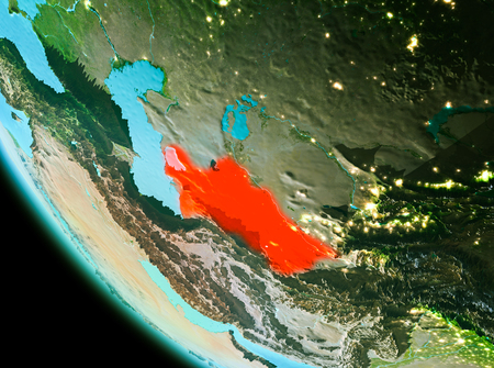 Country of Turkmenistan in red on planet Earth in the evening. 3D illustration. Stock Photo