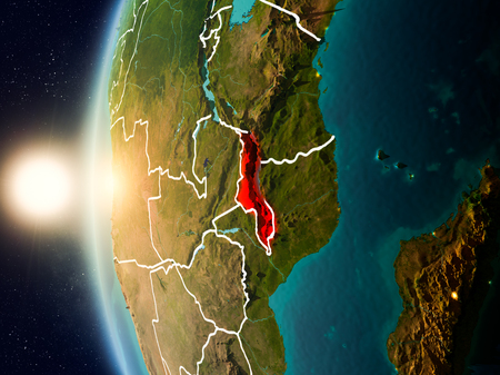 Illustration of Malawi as seen from Earth's orbit during sunset with visible country borders. 3D illustration. Stock Photo