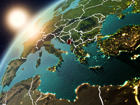 Montenegro during sunset highlighted in red on planet Earth with visible country borders. 3D illustration.