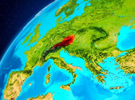 惑星地球上で赤色で強調表示されたオーストリアの軌道図。3Dイラスト。