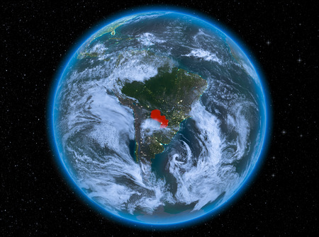Night view of Paraguay highlighted in red on planet Earth with atmosphere and clouds. 3D illustration.