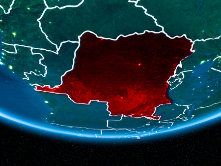 Democratic Republic of Congo in red with visible country borders and city lights from space at night. 3D illustration.
