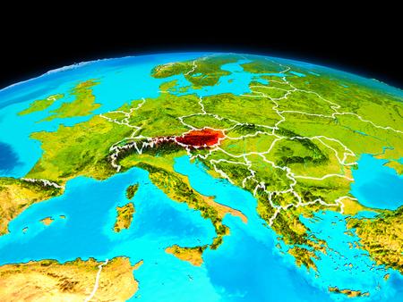 オーストリアの衛星ビューは、境界線で惑星地球上で赤で強調表示されます。3Dイラスト。 写真素材