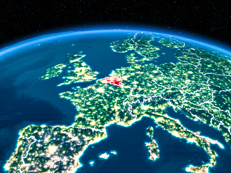 Orbit view of Belgium highlighted in red with visible borderlines and city lights on planet Earth at night. 3D illustration. Stock Photo