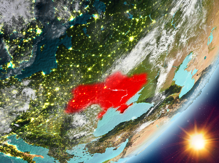 Ukraine from orbit of planet Earth in sunrise with highly detailed surface textures and clouds. 3D illustration.