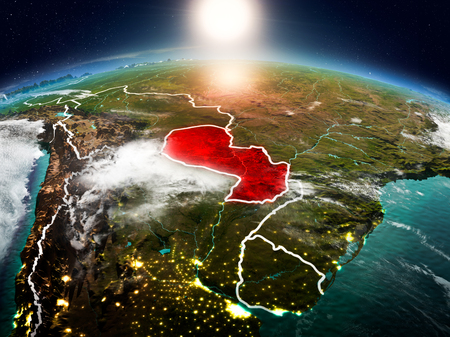 Sunrise above Paraguay highlighted in red on model of planet Earth in space with visible country borders. 3D illustration.