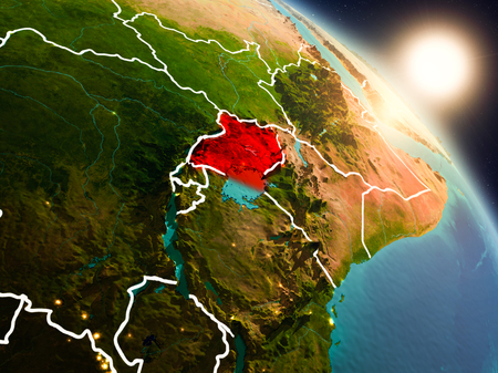 Sunset above Uganda from space on planet Earth with visible country borders. 3D illustration.