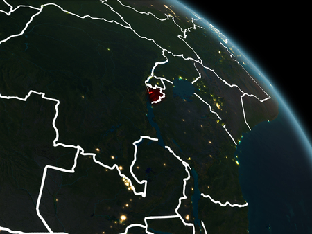 Burundi from orbit of planet Earth at night with visible borderlines and city lights. 3D illustration.