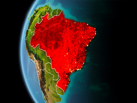 Evening over Brazil as seen from space on planet Earth with visible border lines and city lights. 3D illustration.