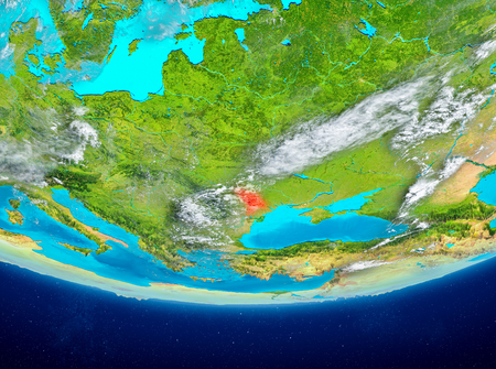 Moldova highlighted in red on planet Earth with clouds. 3D illustration. Stock Photo