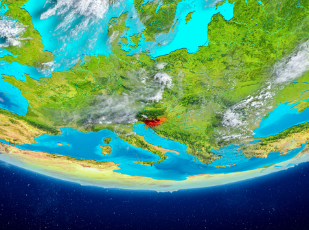 Slovenia highlighted in red on planet Earth with clouds. 3D illustration.