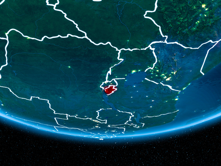 Burundi in red with visible country borders and city lights from space at night. 3D illustration. Stock Photo
