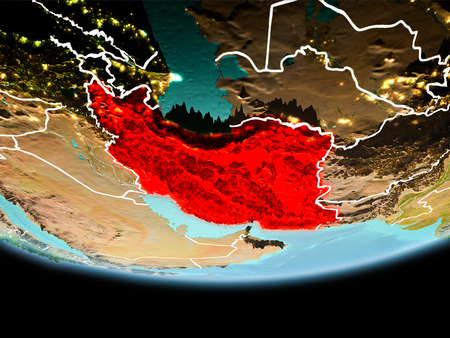 Country of Iran in red on planet Earth in the evening with visible border lines and city lights. 3D illustration.