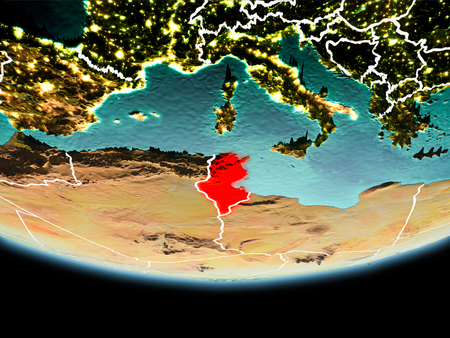 Country of Tunisia in red on planet Earth in the evening with visible border lines and city lights. 3D illustration. Stock Photo