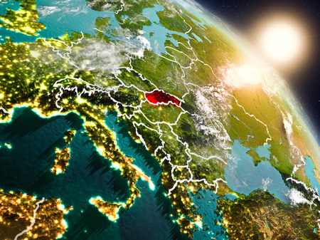 Sunset above Slovakia from space on planet Earth with visible country borders. 3D illustration.