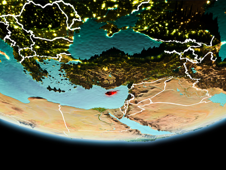 Country of Cyprus in red on planet Earth in the evening with visible border lines and city lights. 3D illustration.