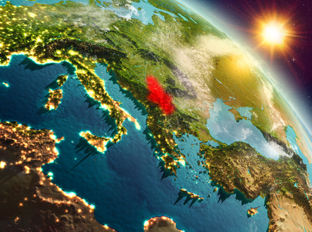 Sunrise above Serbia highlighted in red on model of planet Earth in space. 3D illustration.