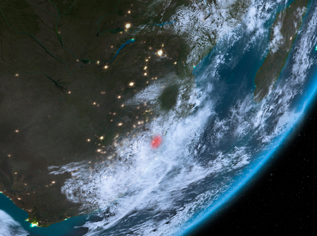 Swaziland from orbit of planet Earth at night with highly detailed surface textures and clouds. 3D illustration.