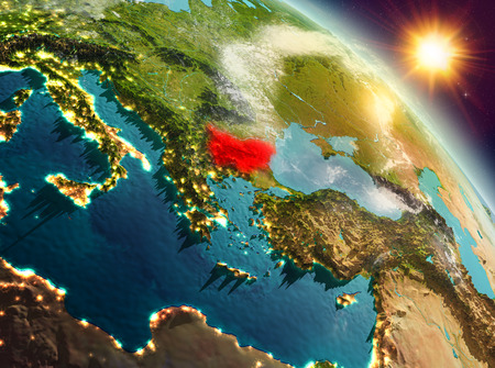 Sunrise above Bulgaria highlighted in red on model of planet Earth in space. 3D illustration. Stock Photo