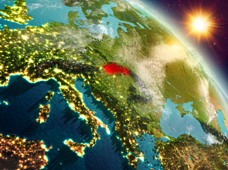 Sunrise above Slovakia highlighted in red on model of planet Earth in space. 3D illustration. Stock Photo