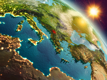 Sunrise above Kosovo highlighted in red on model of planet Earth in space. 3D illustration.