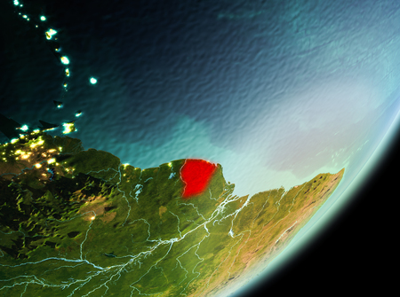 French Guiana in the morning highlighted in red on planet Earth. 3D illustration.