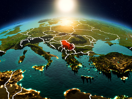 Sunrise above Serbia highlighted in red on model of planet Earth in space with visible country borders. 3D illustration.