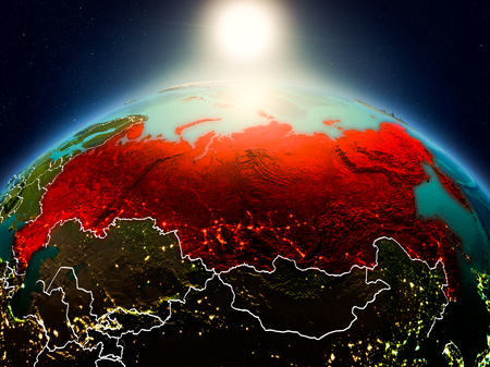 Sunrise above Russia highlighted in red on model of planet Earth in space with visible country borders. 3D illustration.