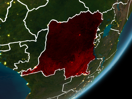 Democratic Republic of Congo as seen from Earth's orbit on planet Earth at night highlighted in red with visible borders and city lights. 3D illustration. Stock Photo