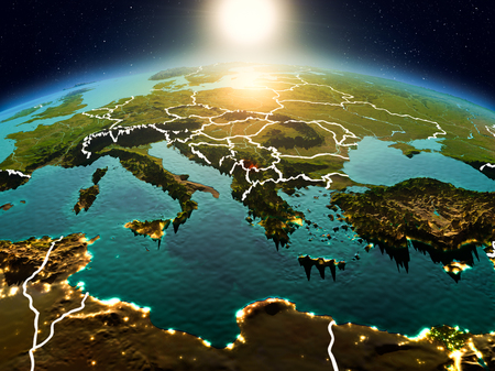 Sunrise above Kosovo highlighted in red on model of planet Earth in space with visible country borders. 3D illustration. Stock Photo