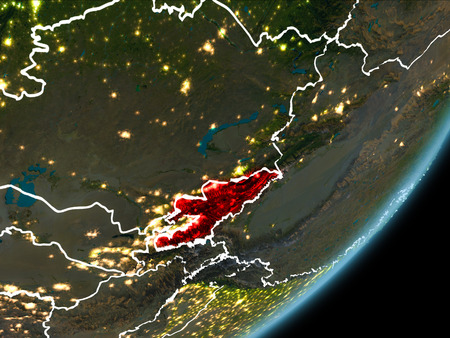 Kyrgyzstan as seen from Earth's orbit on planet Earth at night highlighted in red with visible borders and city lights. 3D illustration.