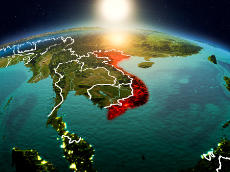 Sunrise above Vietnam highlighted in red on model of planet Earth in space with visible country borders. 3D illustration.