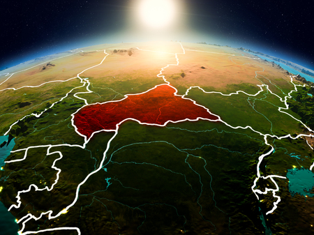 Sunrise above Central Africa highlighted in red on model of planet Earth in space with visible country borders. 3D illustration.