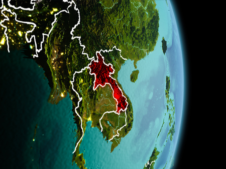 Satellite morning view of Laos highlighted in red on planet Earth with visible border lines and city lights. 3D illustration.
