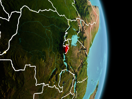 Satellite morning view of Burundi highlighted in red on planet Earth with visible border lines and city lights. 3D illustration. Stock Photo