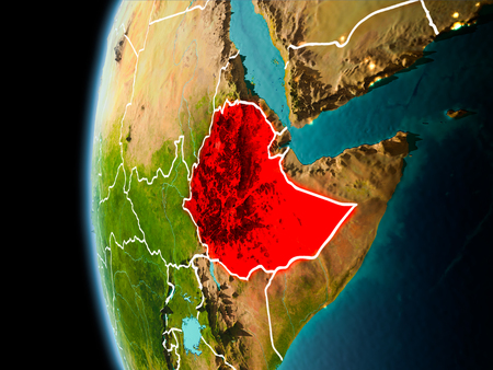 Evening over Ethiopia as seen from space on planet Earth with visible border lines and city lights. 3D illustration.
