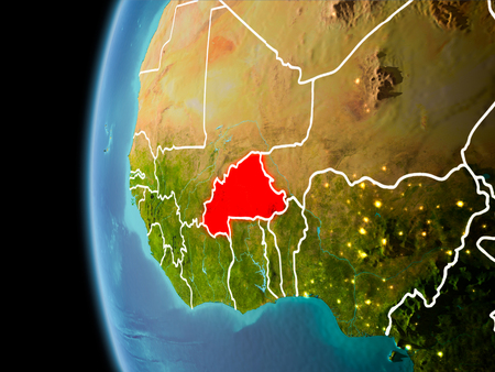 Evening over Burkina Faso as seen from space on planet Earth with visible border lines and city lights. 3D illustration.