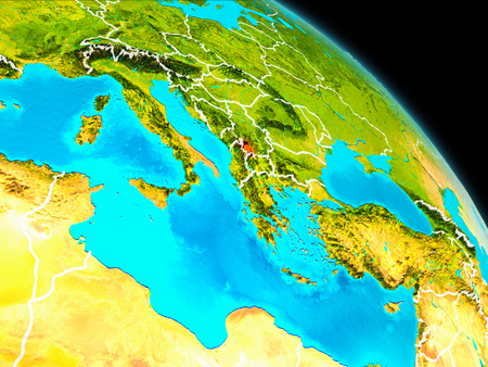 Space orbit view of Kosovo highlighted in red on planet Earth with visible borders. 3D illustration. Stock Photo
