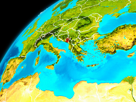 Orbit view of Montenegro highlighted in red with visible borderlines on planet Earth. 3D illustration. Stock Photo