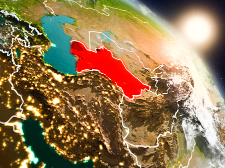 Sunset above Turkmenistan from space on planet Earth with visible country borders. 3D illustration.