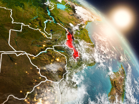 Sunset above Malawi from space on planet Earth with visible country borders. 3D illustration.