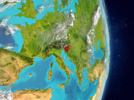 Space view of Slovenia highlighted in red on planet Earth with atmosphere. 3D illustration. Stock Photo