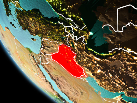 Iraq from orbit of planet Earth at night with highly detailed surface textures with visible border lines and city lights. 3D illustration. Stock Photo