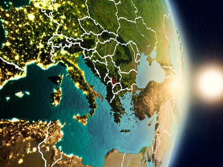 Kosovo during sunrise highlighted in red on planet Earth with visible country borders. 3D illustration.