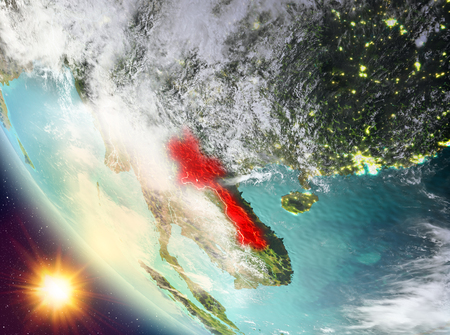 Laos during sunset highlighted in red on planet Earth with clouds. 3D illustration. Stock Photo