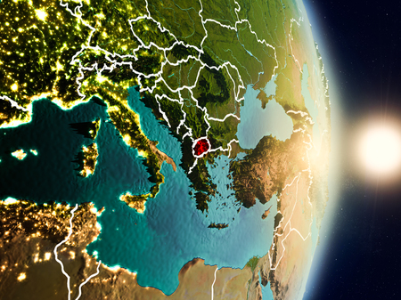 Macedonia during sunrise highlighted in red on planet Earth with visible country borders. 3D illustration.